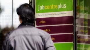A young man enters a job centre