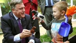 Shadow Chancellor Ed Balls plays with three year old Connor Felton at the Roundabout Children's Centre in Brighton