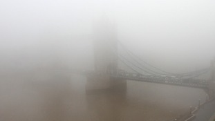 A view of Tower Bridge in fog in central London this morning.