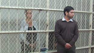 Melissa Reid and Michaela McCollum Connelly behind bars inside the court in Peru.