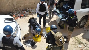 UN chemical weapons experts prepare to collect samples during their last Syria trip last month.
