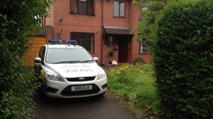 A police car outside the house in Stone today
