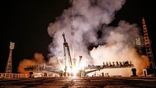 The Soyuz-FG rocket booster with Soyuz TMA-10M space ship carrying a new crew to the ISS, blasts off in Kazakhstan.