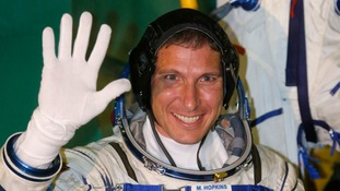 nternational Space Station crew member US astronaut Michael Hopkins waves as he boards the Soyuz TMA-10M spacecraft.