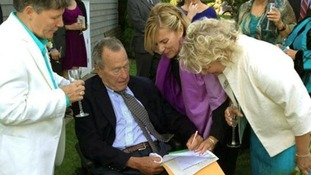Former President George Bush Sr signs the couple's marriage documents.