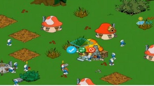 A screen shot of the Smurfs' Village game.