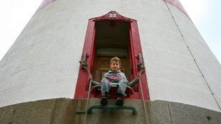 Boy on lighthouse steps