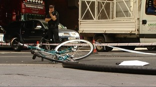 Damaged bike on the ground after the collision with a lorry