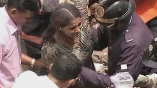 A woman was among those pulled alive from the multi-storey building in Mumbai.