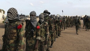Al-Shabaab fighters parade around the Ala Yaasir camp in Somalia, in 2011.