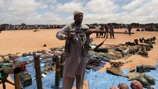An al-Shabaab fighter displays his loot of weapons recovered from peacekeepers, in Somalia in 2011.