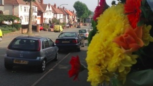 Tributes have been left at the scene where a man was killed following a hit and run collision