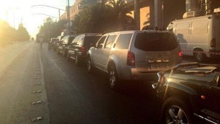 Car waiting to transport Golden Dawn members to the prosecutor's office