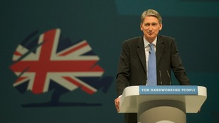 Defence Secretary Philip Hammond addresses delegates on the first day of the Conservative Party conference