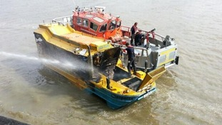 London Fire Brigade work to douse fire on Duck Tours vessel that caught fire on the River Thames.