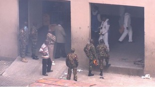 Kenyan soldiers and forensic officers scour the shopping centre in Nairobi for clues