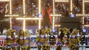 Tinie Tempah accompanied by Minnesota Vikings cheerleaders before the NFL International Series match.