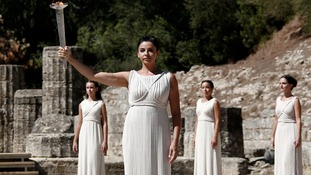 The Olympic flame is raised at the site of Ancient Olympia in Greece.