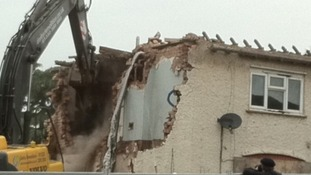 Demolition operation underway at Philpott home