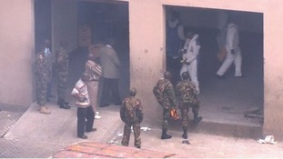 Kenyan soldiers and forensic officers search the Westgate shopping centre