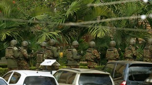 Kenyan soldiers enter the main gate of the Westgate shopping centre