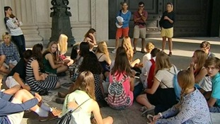 School children gather outside the National Archives which have been closed as a part of the US shutdown.