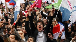 Supporters of Francois Hollande celebrate outside Socialist Party campaign headquarters in Paris