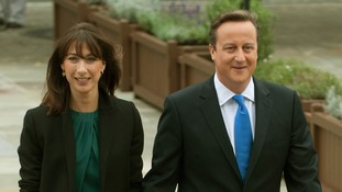Prime Minister David Cameron arrives with his wife Samantha before giving his keynote speech