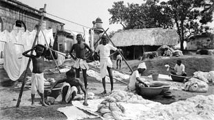 Waterside with group of washermen at a dhobi ghat