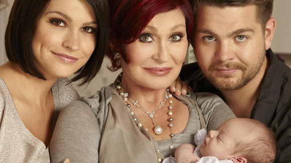 Sharon Osbourne holding her new grandchild Pearl, with proud parents, Jack Osbourne and fiancee Lisa Stelly