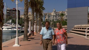 man and woman on sunny promenade