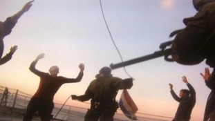 Photo purportedly showing Russian officials holding Greenpeace activists at gunpoint