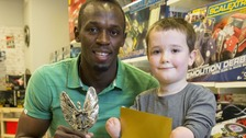 Six-times Olympic gold medallist Usain Bolt with Pride of Britain Award winner, Harley Lane.