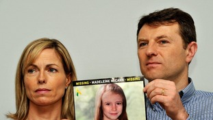 Gerry and Kate McCann hold a picture of daughter Madeleine