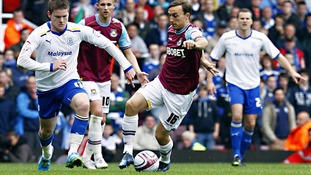 Cardiff City's Aron Gunnarsson and West Ham United's Mark Noble battle for the ball
