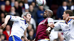 Cardiff City's Kevin McNaughton and West Ham United's Carlton Cole
