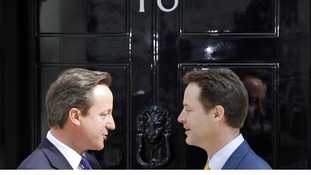 David Cameron (L) talks to Deputy Prime Minister Nick Clegg on the steps of 10 Downing Street