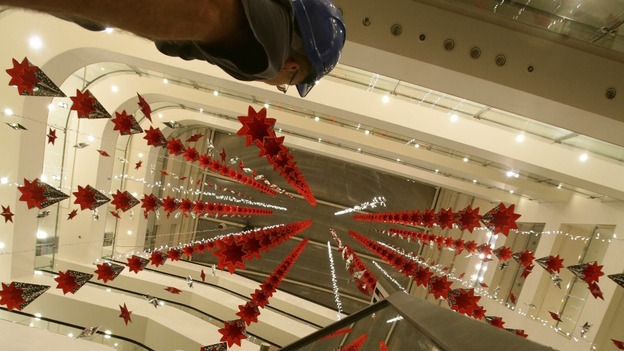 Installation Team Fitting Christmas Decorations In The John Lewis Atrium