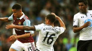 Kyle Naughton (right) and West Ham United's Ravel Morrison (left) seen during the game on Sunday
