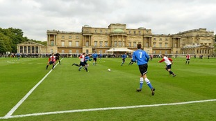 Polytechnic FC (in blue), during their match with the Civil Service FC in Buckingham Palace's garden