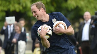 Duke of Cambridge trains with members of the Royal household during the second half of the match
