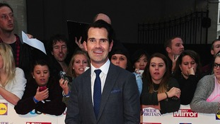 Comedian Jimmy Carr smiles as he arrives for the 15th Annual Pride of Britain awards.