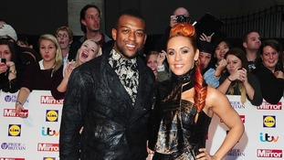 Oritse Williams and AJ Azarie arriving at the awards at Grosvenor House.