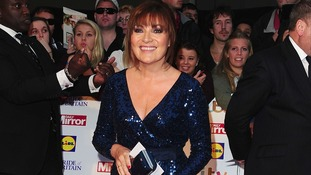 Lorraine Kelly dazzled in a deep blue glittery dress as she arrived at Grosvenor House.