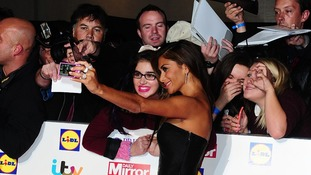 Nicole Scherzinger took time to take pictures with fans on the red carpet.