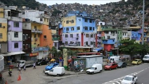 Brazil's police dawn raids attempt to tame the favelas.