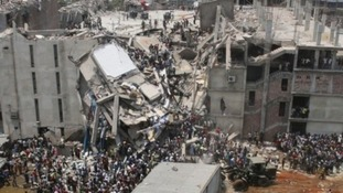 Crowds gather at the collapsed Rana Plaza building in Dhaka, Bangladesh