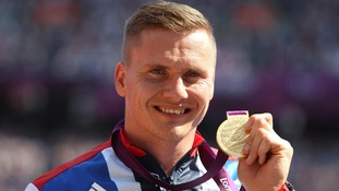 David Weir with his gold medal after winning the Men's 5000m - T54 at the Olympic Stadium, London