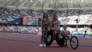David Weir celebrates with his children Ronie, Tillia Grace and Mason at the Olympic Stadium in London