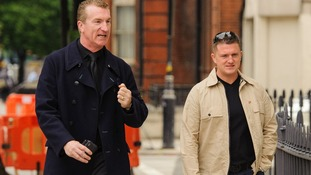 English Defence leaders Kevin Carroll (left) and Tommy Robinson